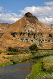 Sheep Rock in the John Day Fossil Beds National Monument. The blue bucket deposit is thought to be near the John Day River.